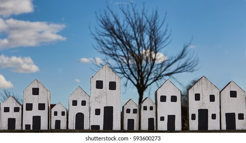 The white wooden house row against blue skay.