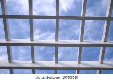 white wooden lattice against the blue sky