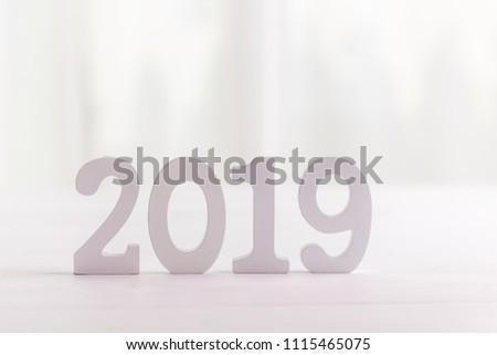 white wooden letters on white background 2019 happy new year