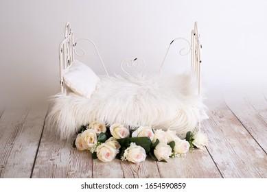 white wooden log bed for newborns