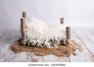 white wooden log bed for newborns