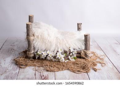 white wooden log bed for newborns - Shutterstock ID 1654590862