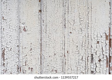 White wooden plank background with cracked painting