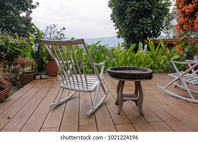 white wooden rocking chair in the terrace