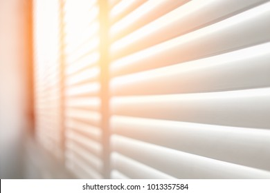 White wooden shutters, White wooden blind with sunlight.