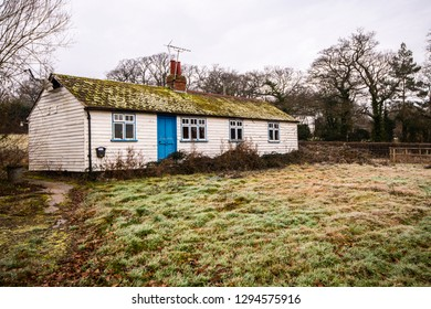 White wooden Sussex Weatherboarding on an old cottage at Newenden in Kent, England. This is a traditional wall covering used in an arts and crafts method locally.