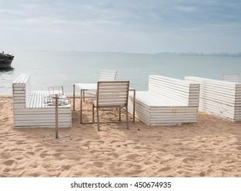White wooden table set on sand beach