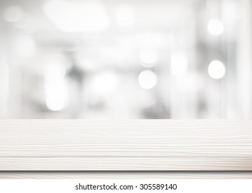 White wooden table top background over bokeh light, Empty counter surface in blur room background, White wood shelf, table  for retail shop, store product display, mock up,  template banner