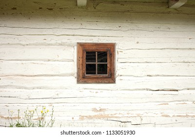 white wooden wall painted with lime, an old log house rustic village