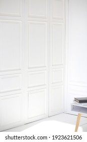 White wooden wall in a room with daylight. Minimalist style. Design and interior concept. Copy space