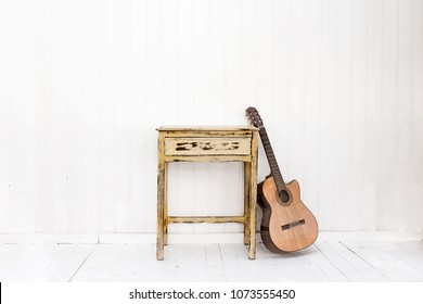 white wooden wall with rustic furniture, white wall background,