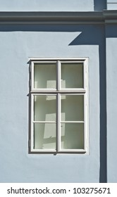 white wooden window at light blue colored house