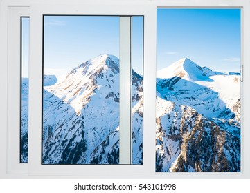 white wooden windows opened with views of the peaks of snowy mountains