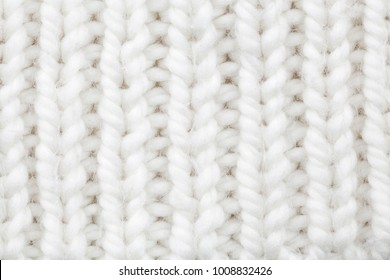 White wool texture. Texture of wool. Knitting natural wool white background.