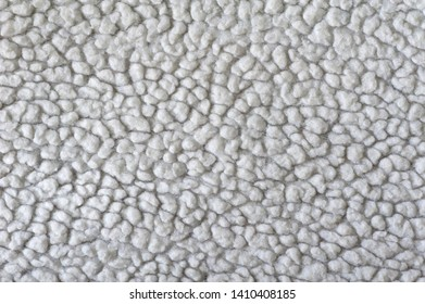 white wool texture, lumps on the fabric, white texture of coat,
