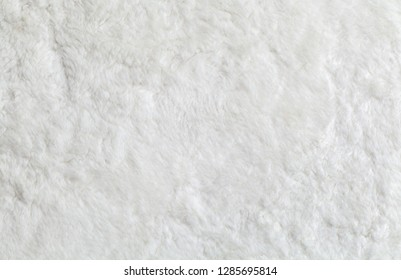 white wool top view texture background, light natural sheep wool, white  fluffy fur for designers, close-up fragment white wool carpet