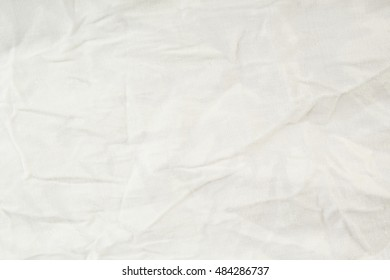 White wrinkled fabric texture. Closeup
