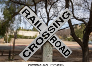 White X shaped rail road crossing sign.