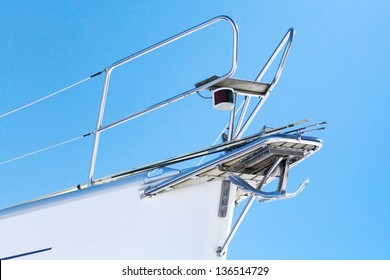 White yacht bow fragment with railing and anchor