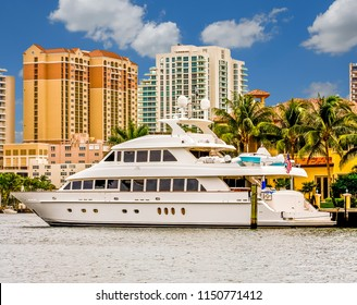 White Yacht by Condo Towers