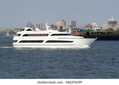 A white yacht cruising in New York Harbor
