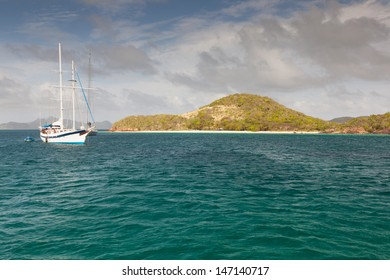 White yacht near the Caribbean island
