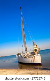 White Yacht nearly the beach