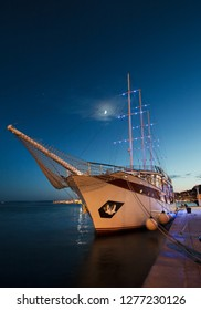 The white yacht in the night port.