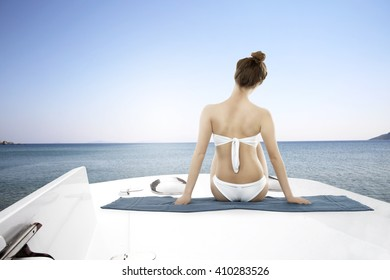 white yacht on sea and woman