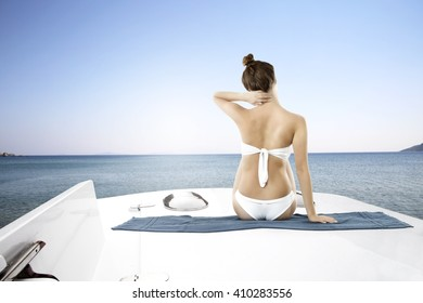 white yacht on sea and woman in bikini