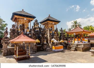 White and yellow altars of Pura Dalem Segara Madhu or Pura Dalem Jagaraga - a northern Balinese Hindu temple. Jagaraga village, Buleleng, Bali, Indonesia.