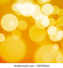 White and yellow bokeh on orange background