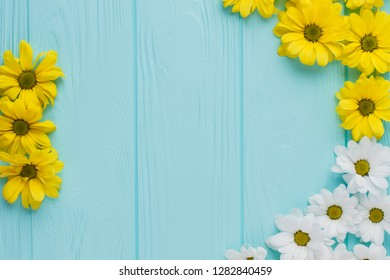 White and yellow chamomile flowers composition. Top view. Flat lay, top view.