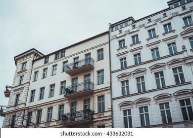 white and yellow facade of vintage buildings at berlin