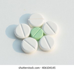 white Yellow green tablet pills capsules on white background
