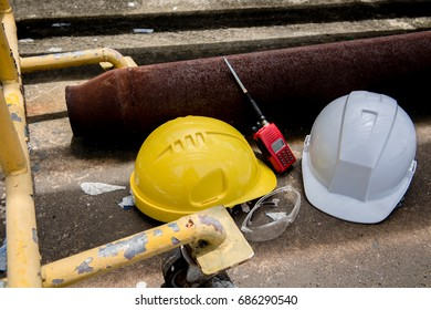 white and yellow hard safety helmet hat and radio communication in industrial plant