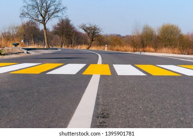 white yellow markings on the road, pedestrian crossing outside the city