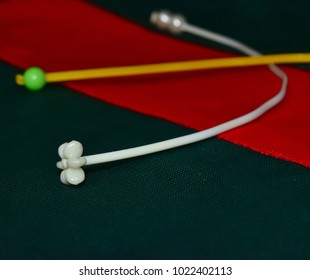 White & yellow plastic objects kept on top of a clothes stock photograph