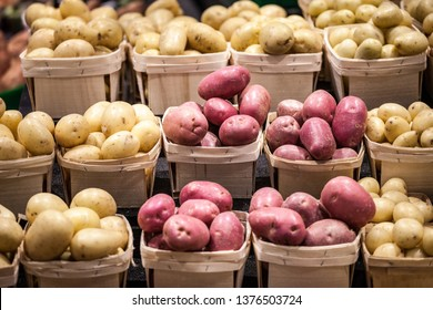 White, yellow and red potatoes on a Canadian market in Montreal, Quebec. Potatoes are one of the biggest productions of Quebec agricutlure, being exported all accross Canada and America