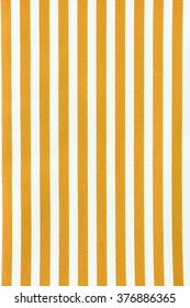 white and yellow striped fabric texture.