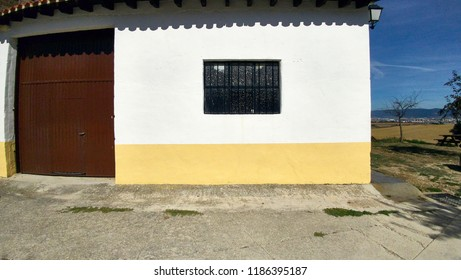 white and yellow wall with latticed window in black color