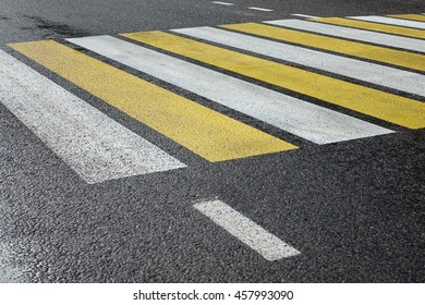 White Yellow Zebra Pedestrian Crossing On The Black Asphalt Street Road