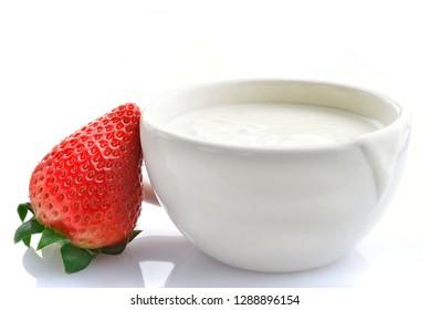 White yogurt with strawberry - close-up