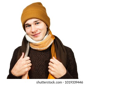 White young guy in a hat and sweater wrap neck a scarf, isolated on a white background.