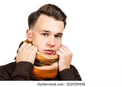 White young guy wrap neck a scarf. Isolated on a white background.