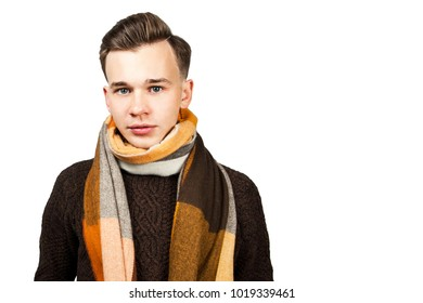 White young in sweater guy wrap neck a scarf. Isolated on a white background.
