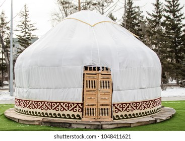 White yurt on the street in winter Kazakhstan