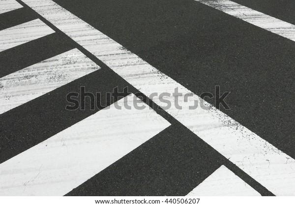 White zebra crossing on the cityscape car road
