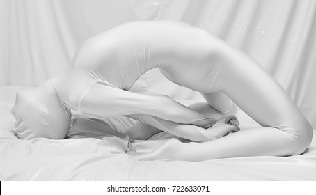 white zentai fetish girl in the bed alone