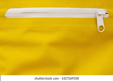 White Zipper in a Yellow Sports Backpack. Zippers Background